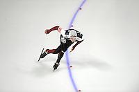 SCHAATSEN: Calgary: Essent ISU World Sprint Speedskating Championships, 28-01-2012, 1000m Heren, Haralds Silovs (LAT), ©foto Martin de Jong