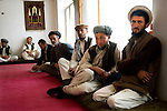 Farghamanch mullah Shamsullah, far right, 35, is active on the local shura in, shown here with other Jurm district shura leaders at a meeting in Madrassa, Jurm district, Badakhshan province, Afghanistan, Friday afternoon, Oct. 23, 2009. An extremely conservative leader, Shamsullah lived for ten years in Pakistan, where he attended madrassas and began to follow Gulbuddin Hekmatyar, former Afghan mujahideen leader and founder of the hard-line Hezb-i-Islami party. Politics and power structures often change from village to village in Afghanistan. As the Obama Administration seeks the formula for turning the tide of the war in Afghanistan, some aid organizations are advocating the National Solidarity Programme, a community-based development program that has made progress in some districts, setting up local councils that propose much-needed projects such as schools, drinking water facilities and roads.