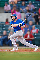 Midland RockHounds center fielder J.P. Sportman (25) follows through on a swing during a game against the Arkansas Travelers on May 25, 2017 at Dickey-Stephens Park in Little Rock, Arkansas.  Midland defeated Arkansas 8-1.  (Mike Janes/Four Seam Images)