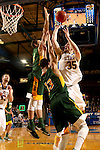 BROOKINGS, SD - DECEMBER 28:  A.J. Hess #35 from South Dakota State takes the ball to the basket against a pair of defenders including Khy Kabellis #13 from North Dakota State during their game Wednesday night at Frost Arena in Brookings. (Dave Eggen/Inertia)