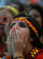 A Spain soccer fan reacts in frustration as she watches the live broadcast of the World Cup match between Spain and the Netherlands inside the FIFA Fan Fest area on Copacabana beach, Rio de Janeiro, Brazil, June 13, 2014