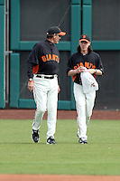 Dave Righetti #19 , pitching coach, of the San Francisco Giants and Tim Lincecum ##55 come in from the bullpen prior to the game against the Arizona Diamondbacks in the first spring training game of the season at Scottsdale Stadium on February 25, 2011  in Scottsdale, Arizona. .Photo by:  Bill Mitchell/Four Seam Images.