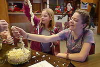 NWA Democrat-Gazette/BEN GOFF @NWABENGOFF<br /> Allyson Ribar (left) and Hadassah Wallingford, both 12 and from Rogers, make popcorn garlands on Sunday Nov. 29, 2015 during the annual open house at the Rogers Historical Museum.