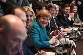 German Chancellor Angela Merkel (C), with Ivanka Trump (left center), smiles during a roundtable discussion on vocational training with United States and German business leaders, lead by President Donald Trump (not seen), in the Cabinet Room of the White House in Washington, DC on March 17, 2017.        <br /> Credit: Photo by Pat Benic / Pool via CNP