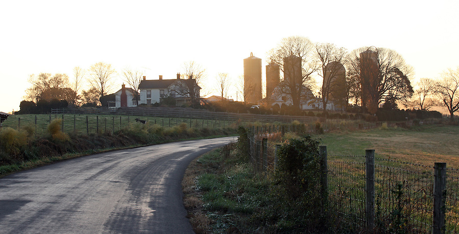 Sun rises over a local farm and winding roadside in Albemarle, County. Photo/ Andrew Shurtleff