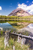 Buller Peak casting it's reflection upon the waters of Buller Pond in Kananaskis Country of Alberta Canada
