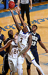 BROOKINGS, SD - FEBRUARY 4:  Chris Howell #3 from South Dakota State University lays the ball up past Emmanuel Nzekwesi #23 from Oral Roberts during their game Saturday afternoon at Frost Arena in Brookings.(Photo by Dave Eggen/Inertia)