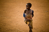 """Portait of  a child running in Nyori refugee camp in Congo. The LRA has been attacking villages in Congo since late 2008 and kidnapping children as young as 5 years old. the boys serve as porters or soldiers in training and the girls  are given to LRA soldiers as """"wives."""""""