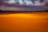 Dunes and storm, Jebel Acacus, LIbya, Mountains in Sahara Desert UNESCO World Heritage Site, The Awiss  Africa