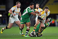 Ben Jacobs of Wasps is tackled by Ofisa Treviranus and Eoin Sheriff of London Irish. Aviva Premiership match, between London Irish and Wasps on November 28, 2015 at Twickenham Stadium in London, England. Photo by: Patrick Khachfe / JMP