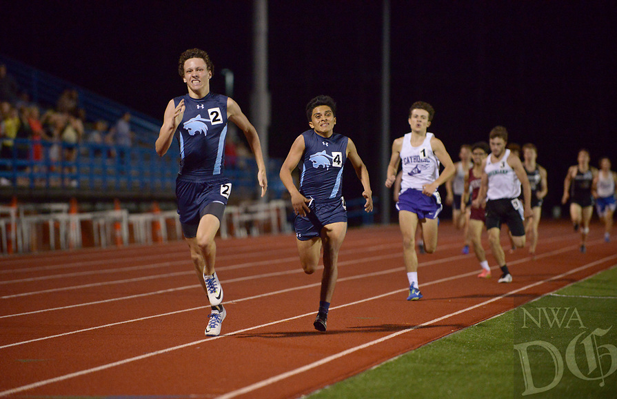 NWA Democrat-Gazette/BEN GOFF @NWABENGOFF<br /> Ethan Carney (2) sprints to the finish line against Springdale Har-Ber teammate Juan Gomez in the boys 800 meter run Thursday, April 20, 2017, during the McDonald Relays at Fort Smith Southside. Carney won with a time of 1:59.75 minutes.
