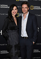 "LOS ANGELES - APRIL 7: Julianna Margulies and Topher Grace attend a World Health Day dinner and first look at National Geographic's ""The Hot Zone"" at the Terrace Room at Sunset Tower Hotel on April 7, 2019 in Los Angeles, California. (Photo by Frank Micelotta/National Geographic/PictureGroup)"