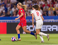 LYON,  - JULY 2: Lindsey Horan #9 dribbles during a game between England and USWNT at Stade de Lyon on July 2, 2019 in Lyon, France.