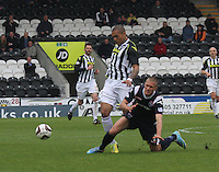 Erik Cikos tackles Josh Magennis in the St Mirren v Ross County Scottish Professional Football League Premiership match played at St Mirren Park, Paisley on 3.5.14.