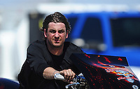 Mar. 31, 2012; Las Vegas, NV, USA: NHRA top fuel Harley motorcycle rider XXXX during qualifying for the Summitracing.com Nationals at The Strip in Las Vegas. Mandatory Credit: Mark J. Rebilas-