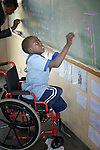 A girl in a wheelchair writes on the blackboard at the Jairos Jiri School in Harare, Zimbabwe.