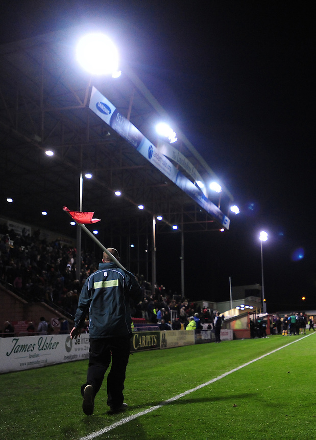 A member of the ground staff at Lincoln City collects the corner flag at the final whistle<br /> <br /> (Photo by Chris Vaughan/CameraSport)<br /> <br /> Football - The Skrill Premier - Lincoln City v Tamworth - Tuesady 8th October 2013 - Gelder Group Sincil Bank Stadium - Lincoln<br /> <br /> &copy; CameraSport - 43 Linden Ave. Countesthorpe. Leicester. England. LE8 5PG - Tel: +44 (0) 116 277 4147 - admin@camerasport.com - www.camerasport.com