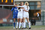 29 November 2013: Virginia Tech's Katie Yensen (3) celebrates her game-winning goal with only 13.5 seconds left in the first half with Ellie Zoepfl (7) and Ashley Manning (behind). The Virginia Tech University Hokies played the Duke University Blue Devils at Thompson Field in Blacksburg, Virginia in a 2013 NCAA Division I Women's Soccer Tournament Quarterfinal match. Virginia Tech won the game 3-0.