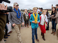 NWA Media/JASON IVESTER --12/16/2014--<br /> Gunnison Riggins (center), 10, arrives with family on Tuesday, Dec. 16, 2014, in a limousine for a ceremony inside the Rogers High gym. With support from the school's DECA program, Gunnison's family was given a trip to Hawaii with the Make-A-Wish Foundation. Gunnison has been diagnosed with neuroblastoma.