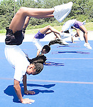 From left, Elite Cheer Action cheerleaders Donielle Taylor, 11, Lauren Hall, 9, and Tiara Briscoe, 11, all of Camp Springs perform back flips during Community Day hosted by the Beltway Church of Christ in Camp Springs on Saturday morning.