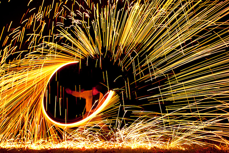 October 22, 2011 - Rochester Institute of Technology juggling club member Sam Owen spins burning steel wool during the juggling club's semi-annual Juggle in the Park at Dark event at the Genesse Valley Park.