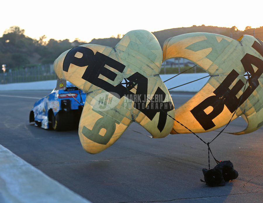 Nov 11, 2017; Pomona, CA, USA; Detailed view of the parachutes of NHRA funny car driver John Force during qualifying for the Auto Club Finals at Auto Club Raceway at Pomona. Mandatory Credit: Mark J. Rebilas-USA TODAY Sports