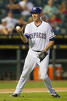 Round Rock Express pitcher Scott Richmond (55) grabs an errant baseball during the Pacific Coast League baseball game against the New Orleans Zephyrs on June 30, 2013 at the Dell Diamond in Round Rock, Texas. Round Rock defeated New Orleans 5-1. (Andrew Woolley/Four Seam Images)