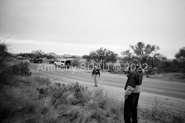 Three Points, Arizona.USA.October 23, 2006..Neil Wendting of Nevada, and Ed Hart from Alabama, are members of the Minuteman Civil Defense Corps of Arizona. Not far from the the King Anvil Ranch they stop 4 Mexicans who have crossed the border illegal. One of them offers the four men water and then stands by them until the Arizona border patrol arrives to arrest them and deport them back to Mexico. They search here after seeing other movement near by.