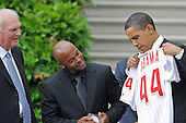 Washington, D.C. - May 15, 2009 -- United States President Barack Obama, right, looks at the jersey presented to him by shortstop Jimmy Rollins, center, as he welcomes the 2008 Baseball World Champion Philadelphia Phillies to the White House in Washington, D.C. on Friday, May 15, 2009.  Phillies manager Charlie Manuel looks on from left..Credit: Ron Sachs / Pool via CNP
