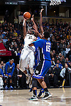 Greg McClinton (11) of the Wake Forest Demon Deacons shoots over Jahlil Okafor (15) of the Duke Blue Devils during first half action at the LJVM Coliseum on January 7, 2015 in Winston-Salem, North Carolina.  The Blue Devils defeated the Demon Deacons 73-65.  (Brian Westerholt/Sports On Film)