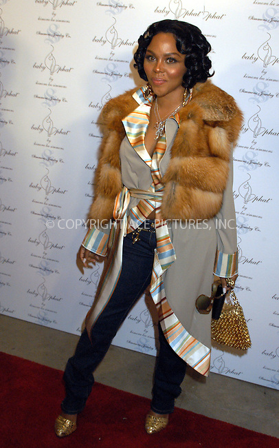 WWW.ACEPIXS.COM . . . . . ....NEW YORK, FEBRUARY 5, 2005....Lil Kim at the Baby Phat Fall 2005 fashion show.....Please byline: KRISTIN CALLAHAN - ACE PICTURES.. . . . . . ..Ace Pictures, Inc:  ..Philip Vaughan (646) 769-0430..e-mail: info@acepixs.com..web: http://www.acepixs.com