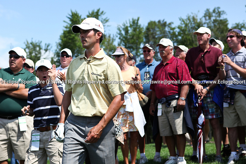 Mike Weir and fans react after Weir chipped the ball onto 5th hole during the Notah Begay III foundation Challenge at Atunyote golf course.