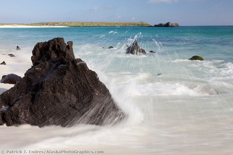 Waves crash along Gardner beach, Espanola Island, Galapagos Islands, Ecuador.