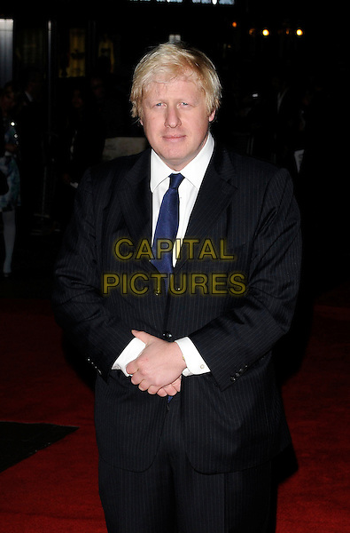 BORIS JOHNSON, Mayor Of London.attends the premiere for 'Bright Star' during the Times BFI 53rd London Film Festival at the Odeon Leicester Square, London, England,.October 19th 2009..half length  black pinstripe suit navy blue tie white shirt .CAP/CAN.©Can Nguyen/Capital Pictures.