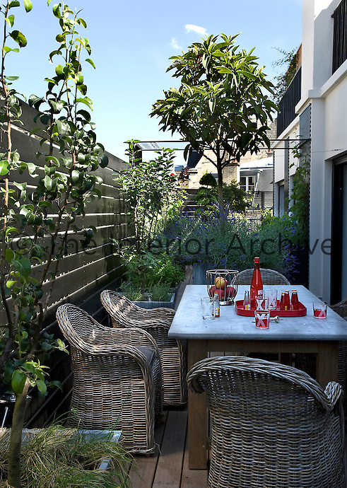 The terrace leading from the kitchen provides an outdoor eating area when the weather is fine