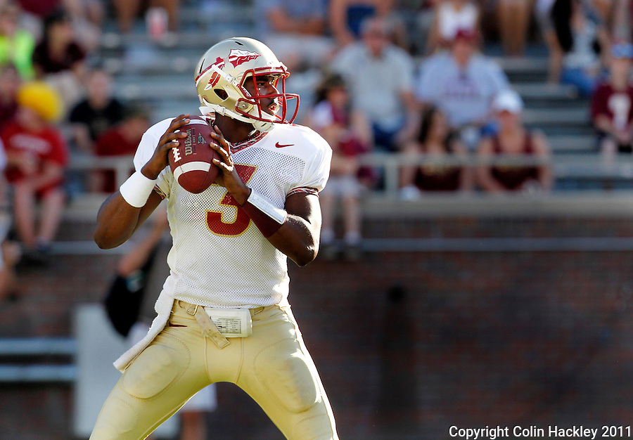 TALLAHASSEE, FLA. 4/16/11-FSUG&G041611 CH-Gold quarterback EJ Manuel looks for a receiver during second half action in the Florida State University Garnet and Gold game Saturday in Tallahassee. Garnet beat Gold 19-17..COLIN HACKLEY PHOTO