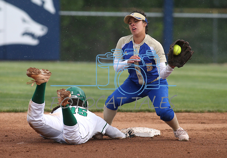 Rancho's Yvette Sanchez dives back against Reed's Alexis Gonzalez during NIAA DI softball action at the University of Nevada, in Reno, Nev., on Friday, May 20, 2016. Rancho won 12-0 in five innings to advance to the championship. Cathleen Allison/Las Vegas Review-Journal