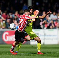 Lincoln City's Shay McCartan vies for possession with Cheltenham Town's Conor Thomas<br /> <br /> Photographer Chris Vaughan/CameraSport<br /> <br /> The EFL Sky Bet League Two - Lincoln City v Cheltenham Town - Saturday 13th April 2019 - Sincil Bank - Lincoln<br /> <br /> World Copyright &copy; 2019 CameraSport. All rights reserved. 43 Linden Ave. Countesthorpe. Leicester. England. LE8 5PG - Tel: +44 (0) 116 277 4147 - admin@camerasport.com - www.camerasport.com