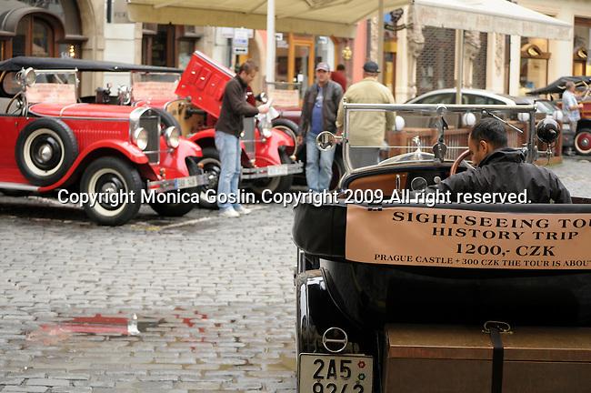 Antique cars now offer tourists rides through Prague, Czech Republic.