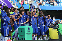 Cesar Azpilicueta of Chelsea holds aloft  the Premier League Trophy during Chelsea vs Sunderland AFC, Premier League Football at Stamford Bridge on 21st May 2017