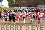 Mad dash for the water at the Fourth Annual Connie Harnett Memorial Swim in Ballybunion on New Years Day.