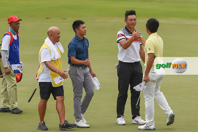 Yuxin LIN (CHN) congratulates Takumi KANAYA (JPN) for winning the Asia-Pacific Amateur Championship, Sentosa Golf Club, Singapore. 10/7/2018.<br /> Picture: Golffile | Ken Murray<br /> <br /> <br /> All photo usage must carry mandatory copyright credit (© Golffile | Ken Murray)