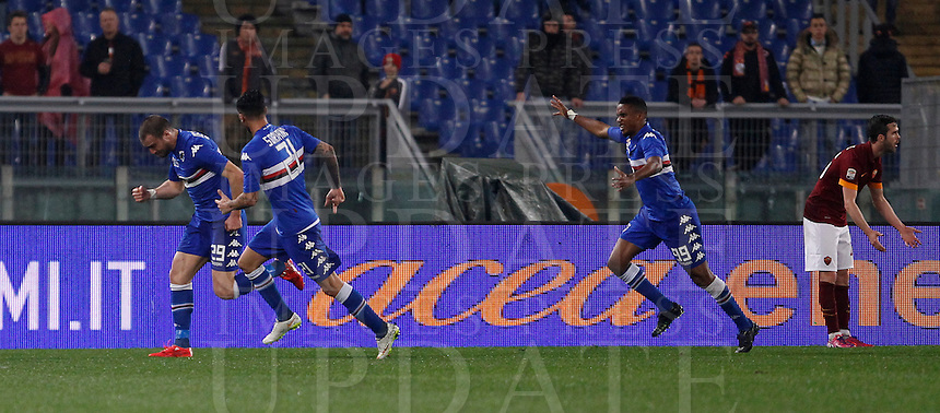 Calcio, Serie A: Roma vs Sampdoria. Roma, stadio Olimpico, 16 marzo 2015. <br /> Sampdoria&rsquo;s Lorenzo De Silvestri, left, celebrates with teammates Roberto Soriano, second from left, and Samuel Eto&rsquo;o, after scoring as Roma&rsquo;s Miralem Pjanic, right, reacts, during the Italian Serie A football match between Roma and Sampdoria at Rome's Olympic stadium, 16 March 2015.<br /> UPDATE IMAGES PRESS/Isabella Bonotto