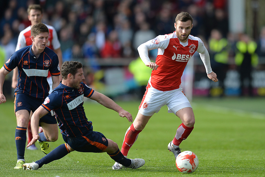 Fleetwood Town's Jimmy Ryan is tackled by Blackpool's David Norris<br /> <br /> Photographer Dave Howarth/CameraSport<br /> <br /> Football - The Football League Sky Bet League One - Fleetwood Town v Blackpool - Saturday 23rd April 2016 - Highbury Stadium - Fleetwood  <br /> <br /> &copy; CameraSport - 43 Linden Ave. Countesthorpe. Leicester. England. LE8 5PG - Tel: +44 (0) 116 277 4147 - admin@camerasport.com - www.camerasport.com