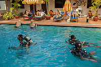 14 February, 2013 - Sihanoukville (Cambodia). Tourists look on as staff from the Cambodia Mine Action Center practice scuba diving in a hotel's pool in Sihanoukville. © Thomas Cristofoletti / Ruom