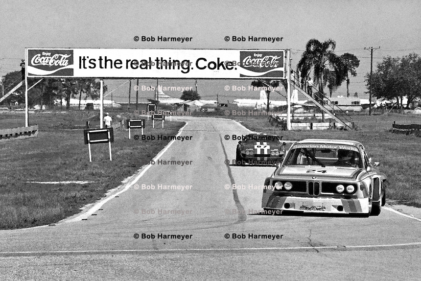 """SEBRING, FL - MARCH 22: The BMW 3.0 CSL of Sam Posey and Hans Stuck is driven into the """"Hairpin"""" turn during practice for the 12 Hours of Sebring IMSA Camel GT race at the Sebring International Raceway near Sebring, Florida, on March 22, 1975. (Photo by Bob Harmeyer)"""