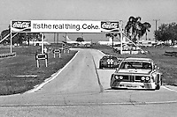 "SEBRING, FL - MARCH 22: The BMW 3.0 CSL of Sam Posey and Hans Stuck is driven into the ""Hairpin"" turn during practice for the 12 Hours of Sebring IMSA Camel GT race at the Sebring International Raceway near Sebring, Florida, on March 22, 1975. (Photo by Bob Harmeyer)"