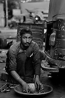 Ghame Singh, now 23, was born 2 years after the Sikh Genocide in 1984. His father who witnessed the killing of the Sikhs suffers from depression and is an alcoholic today. As Ghame's father never used to work  Ghame Singh never went to school and started working at a very younger age.  He still works as a daily wage laborer in a road-side run-down auto rickshaw maintenance garage. He stays in Tilak Vihar with his family. Tilak Vihar in New Delhi is called the widow colony. Widows and children of the Sikhs who were killed in 1984 Sikh Genocide live here. Four thousand Sikhs were killed in 72 hours in Delhi alone but no body till date has been punished for such an inhuman crime. Illiteracy, drug addiction, child labour and immense poverty characterize the area. Twenty five years ago all the male family members above the age of 15 were killed and burnt, leaving their uneducated widows and children behind to suffer, even after 25 years. The present generation is jobless, steeped in alcoholism and have lost their directions in life. November 2009. New Delhi, India, Arindam Mukherjee