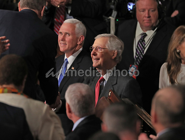 United States Vice President Mike Pence, left, and US Senate Majority Leader Mitch McConnell (Republican of Kentucky), lead their colleagues into the US House chamber prior to US President Donald J. Trump delivering his second annual State of the Union Address to a joint session of the US Congress in the US Capitol in Washington, DC on Tuesday, February 5, 2019. Photo Credit: Alex Edelman/CNP/AdMedia