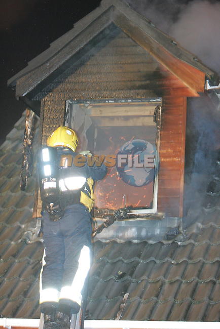 Miracle escape for the Husband and wife  when they dived out the upstairs window of there dormer bungalow after be awoken by neighbours. The male occupant received sever deep cuts to his neck after breaking the window to get out. there were both removed by ambulance to Our Lady of Lourdes Hospital in Drogheda. the Children were not in the house at the time. Three units of Drogheda Fire service tackled the blaze for nearly to hours being hampered by low water pressure in the estate..Photo: Newsfile/Fran Caffrey.